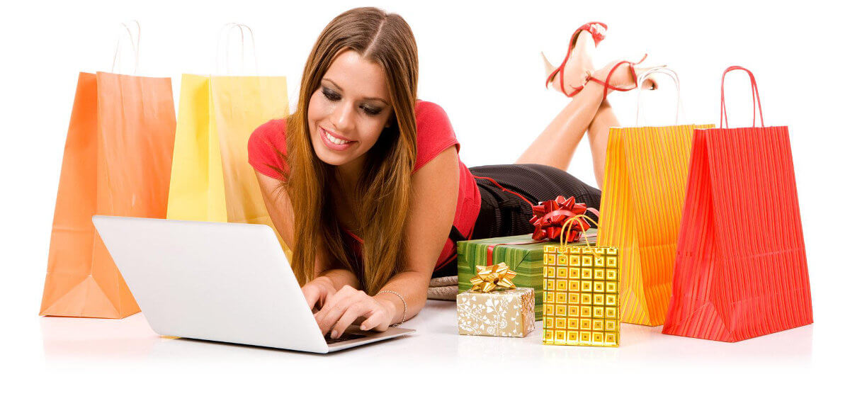 Beautiful young woman shopping over internet.